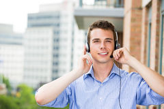 Customer service representative or call center agent or support or operator with headset on outside balcony Stock Image