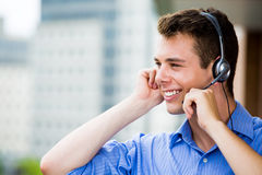 Customer service representative or call center agent or support or operator with headset on outside balcony Stock Photos