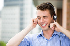 Customer service representative or call center agent or support or operator with headset on outside balcony Royalty Free Stock Images