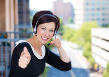 Customer service representative, call center agent, support staff or operator with headset on outside balcony Stock Photos