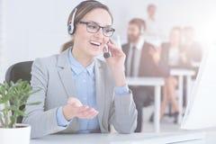 Customer service representative in call center. Busy customer service representative working in call center office Stock Photos