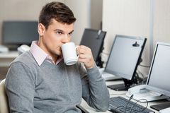 Customer Service Representative Having Coffee Royalty Free Stock Photography