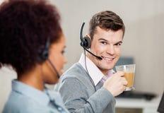 Customer Service Representative Having Tea In Stock Photos