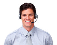Customer service representative with headset on. Happy customer service representative with headset on against a white background Stock Image