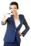 Customer service representative with headset holding a blank emp Royalty Free Stock Photography