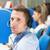 Customer service representative with headset in office Stock Image
