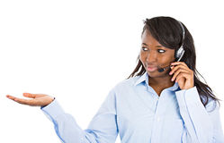 Customer service representative pointing at copy space Royalty Free Stock Image
