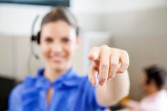 Customer Service Representative Pointing In Office Royalty Free Stock Photo
