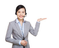 Customer service representative present something Royalty Free Stock Photography