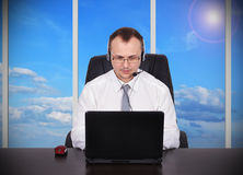Customer service. Representative sitting in office with laptop Royalty Free Stock Images
