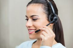 Customer Service Representative Using Headphones Stock Photography