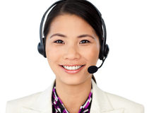 Customer service representative using headset. Smiling customer service representative using headset against a white background Stock Photo