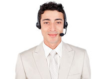 Customer service representative using headset. Attractive customer service representative using headset against a white background Royalty Free Stock Photo