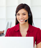 Customer service representative using headset. Self-assured Customer service representative using headset in the office Royalty Free Stock Photography