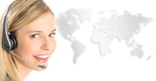 Customer Service Representative Wearing Headset Against World Ma. Close-up portrait of female customer service representative wearing headset with world map Stock Photo