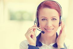 Customer service representative wearing headset at office. Customer service representative wearing a headset isolated on office windows background Stock Image