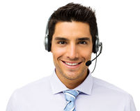 Customer Service Representative Wearing Headset. Portrait of handsome male customer service representative wearing headset isolated over white background Stock Photo