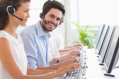 Customer service representative working with colleagues Stock Photo