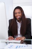Customer service representative working at desk in office royalty free stock photos