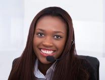 Customer service representative working at desk. Portrait of confident customer service representative working at desk in office Stock Photography