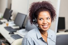 Customer Service Representative Working In Office. Happy female customer service representative working in office Stock Photography