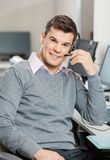 Customer Service Representative Working In Office. Portrait of smiling male customer service representative working in office Royalty Free Stock Image