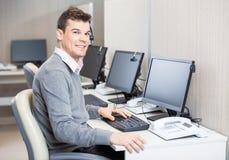 Customer Service Representative Working In Office Stock Image