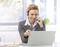 Customer service representative working Stock Images