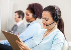 Customer Service Representative Writing On Stock Images