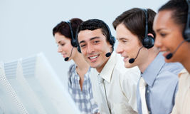 Customer service representatives in a call center. Young customer service representatives with headset on in a call center Stock Photos