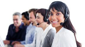 Customer service representatives with headset on. Charismatic customer service representatives with headset on in a call center