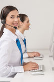 Customer service representatives at work. Stock Photos