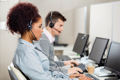 Customer Service Representatives Working In Call Royalty Free Stock Photos