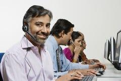 Customer Service Reps in Call Center stock photo