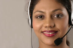 Customer service with smile. Young indian customer service agent with headset Royalty Free Stock Photos