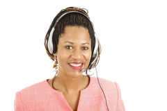 Customer Service with a Smile. Beautiful african-american customer service representative smiling.  Isolated on white Stock Image