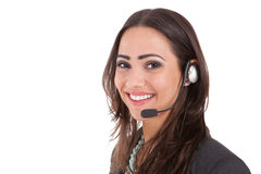 Customer service with a smile. Studio shot of attractive customer service rep Royalty Free Stock Images