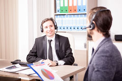 Customer service support working in the office Stock Photos