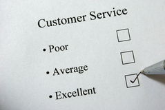 Customer service survey. With pen ticking box Royalty Free Stock Images