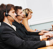 Customer service team. Customer service operators at work Stock Photo