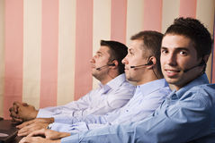 Customer service team with three men. Customer service team with men in office,first man facing you and smiling.Check also,for pictures similar or the same Stock Photos
