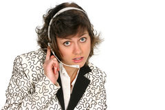 Customer service tech listens over her headset. Friendly customer service tech listens to you over her headset isolated on white Royalty Free Stock Images