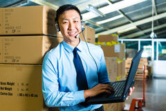 Customer Service in a warehouse Stock Image