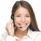 Customer Service Woman. Smiling talking on headset. Close up portrait of beautiful young Caucasian / Asian Stock Image
