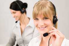 Customer service woman call center phone headset. Customer service team women call center smiling operator phone headset Royalty Free Stock Photo
