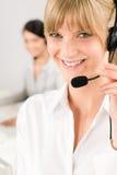 Customer service woman call center phone headset. Customer service team women call center smiling operator phone headset Royalty Free Stock Photos