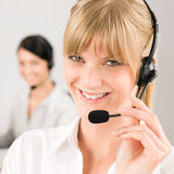 Customer service woman call center phone headset. Customer service team women call center smiling operator phone headset Royalty Free Stock Images