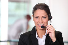 Customer service woman telephoning Stock Photo