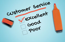 Customer Service word. Customer Service checklist on blue royalty free stock photo