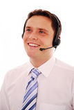 Customer service worker. Friendly male call centre operator on the phone isolated on white Royalty Free Stock Photography